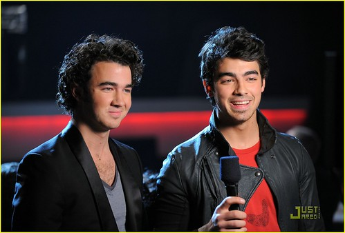 Singers Kevin Jonas and Joe Jonas of The Jonas Brothers speak onstage at The GRAMMY Nominations Concert Live! at Club Nokia on December 2, 2009 in Los Angeles, California.
