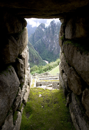 Looking west out a window of Inca design in Machu Picchu, strong design helps this place stand the test of time.