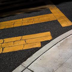 corner crossing (MyArtistSoul) Tags: california street shadow abstract yellow corner square concrete paint minimal cracks asphalt curb ventura 0801 iphone4