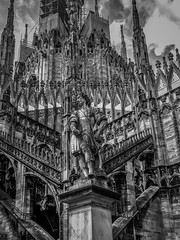 Close up, Duomo di Milano (Sorin Popovich) Tags: milan architecture cathedral gothic artandcraft builtstructure catholicism christianity church day duomodimilano europe italy lombardy lowangleview middistance neoclassical outdoors photography placeofworship shadow sky statue steeple tranquility traveldestinations milancathedral milano blackandwhite monochrome bw