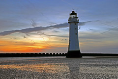 Perch Rock Lighthouse in New Brighton (Steve Wilson - classic view please) Tags: ocean new sunset sea sky lighthouse water rock clouds geotagged nikon brighton long exposure dusk tripod perch d200 peninsula geotag wirral newbrighton nikond200 perchrock perchrocklighthouse mygearandmeplatinum mygearandmediamond