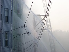 Drowning the apartments with water (Sam T (samm4mrox)) Tags: morning fire chaos smoke maine disaster damage unexpected firefighters lewiston disasters kodakz8612