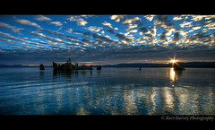 Mono Sunrise (kh-photos ~ Kurt ~) Tags: california sky sun lake reflection 20d water beauty clouds sunrise dawn mono glow explore rays monolake frontpage tufa 1022mm monocounty explore18aug2009