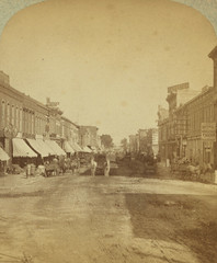 (animated stereo) Commercial st. looking east, Atchison, KS (1870-1890) (Thiophene_Guy) Tags: 19thcentury derivativeworks imagesharedbythewikimediacommons stereoview stereogram stereograph 3d animatedstereo animatedgif history wiggly motionparallax stereo parallax stereophotomaker wiggle animated gif blackandwhite bw sepia monochrome atchison kansas kans kan ks horse buggy wagon conklin kleckner atchisonhistoryproject commercial street 7th seventh thiopheneguy 1870s jiggle jiggly wigglegram ぷるぷる プルプル3d プルプル