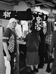 Diner (JanneM) Tags: bw food film japan rollei standing restaurant jan cook xp2 400   osaka 35 kansai ilford umeda janne  noren  moren janmoren