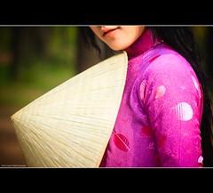 Vietnam | Hue city: The Aodai and conical hat~ (Vu Pham in Vietnam) Tags: pink portrait lady design asia vietnamese dress purple candid patterns traditional vietnam 2009 indochina hu vitnam conicalhat tm hu explored vit odi nnl raininvietnam