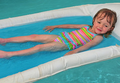 Young Girl on a Pool Float (Jeff Clow) Tags: vacation pool girl kids youth children toddler dfw float relaxation jeffrclow