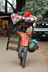 At the Kamakhya mandir (sensaos) Tags: street people india man temple asia north transport east vendor shiva hindu assam northeast 2009 carrier mandir guwahati azie noord oost azië eas kamakhya