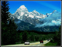 Teton Highway, Wyoming Vacation (moonjazz) Tags: road trip travel vacation mountains green cars nature forest landscape photo big highway view earth postcard large gateway vista geography wyoming geology peaks tetons mighty highest rockymountainsnationalparks