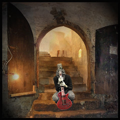 The desperate guitarplayer (pixel_unikat) Tags: door light lamp stairs photoshop austria mood guitar entrance manipulation desperate magazin cellar textured guitarplayer freistadt 500x500 fineartphotos thankstoskeletalmessfortexture