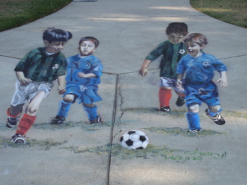 Soccer player mural by Wayne and Cheryl Renshaw