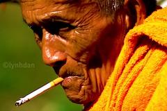 Letting Go Is Always Hard (lynhdan) Tags: orange thailand smoke monk buriram issan earthasia lynhdan