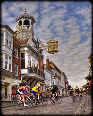 At The Races (strussler) Tags: summer england clock bicycle festival race canon eos 350d town zoom sigma wideangle surrey belltower guildford highstreet hdr guildhall 1735mm photomatix tonemapped outstandingshots singleraw