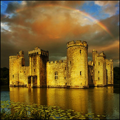 Bodiam under a rainbow (adrians_art) Tags: sky cloud reflection building castle water weather sussex evening rainbow bravo lily moat stronghold fortress bodiamcastle vosplusbellesphotos