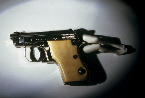 laurie simmons lying gun color