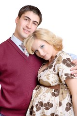 happy couple, pregnant wife (starush) Tags: life family 2 two people woman baby man male love smile vertical female happy glasses healthy md hug couple child dress adult pair father birth young mother happiness husband pregnant romance whitebackground blond wife wait cheer persons cheerful awaiting offspring chisinau brunet armscrossed republicofmoldova