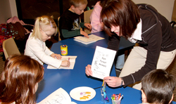 college student teaching kindergarten students in classroom environment