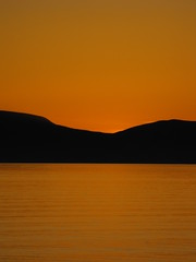 Sunset over the Isle of Arran (shotlandka) Tags: sunset sea orange seascape colour silhouette bright finepix fujifilm isleofarran ardrossan flickraward s1000fd flickraward5 flickrawardgallery ringexcellence