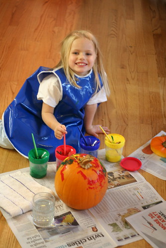 Bella paints her pumpkin