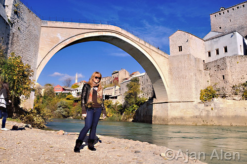 Old bridge and girl in Mostar...