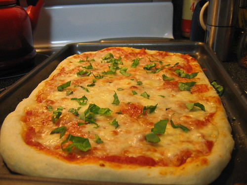 Homemade Three-Cheese Pizza with Fresh Basil
