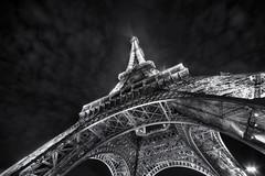 Eiffel Tower by night (Guido Musch) Tags: longexposure blackandwhite paris france night clouds nikon eiffeltower explore toureiffel frankrijk frontpage parijs congrats sigma1020 d40 guidomusch notextremelong oneofthebiggestlighthousesiveseen idontreallylikethetwolightsintherightcornor begrijpnuwaarjijjetaginspiratiekrijgt noghoststoday oraretheyhere onlyfiveseconds not40minutesliketheonejoelwillpostthisafternoon okkklekkerkwijlopjetoetsenbord
