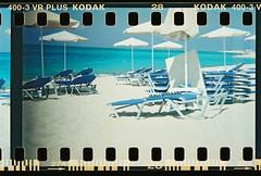 Plaka Beach (aledlewis) Tags: 35mm lens lomo wideangle perforations superwideangle sprocketholes perfs lomodiana