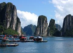 Off the coast (MastaBaba) Tags: sea water rising boat vietnam rise karst halongbay crabwalk 20090920