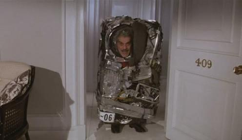Omar Sharif in a very compact car indeed