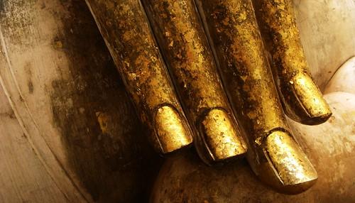 Gold leafed fingers of Buddha - Sukhothai, Thailand