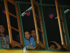 thai children at windowsill