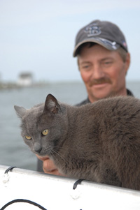 Mayor of Tangier Island with a cat