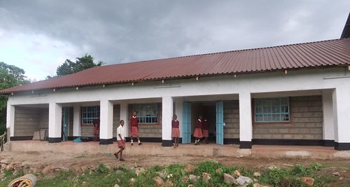 Girls moving into the new dormitory