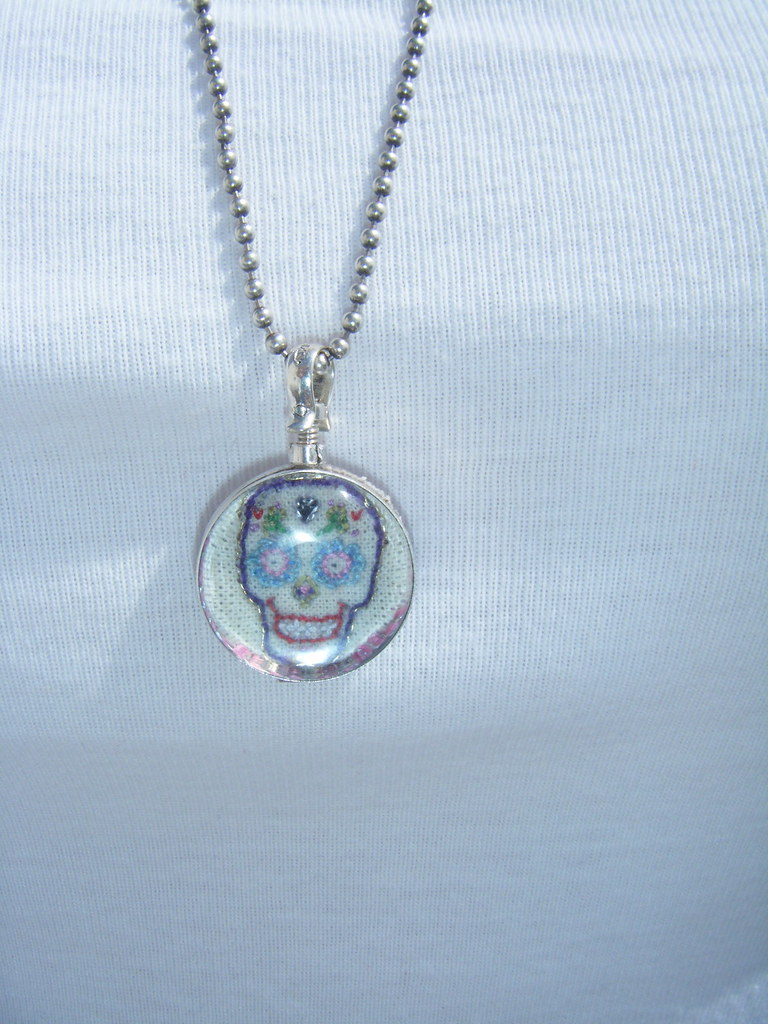 Hand Embroidered Day of Dead Art Piece in a Two Sided Glass Locket , Sterling Silver Mounted Pendant