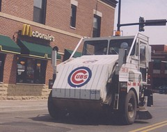 A City of Chicago Department of Streets and Sanitation Elgin Pelican street sweeper vechicle on West Fullerton Avenue near North Halsted Street. Chicago Illinois. September 2002.
