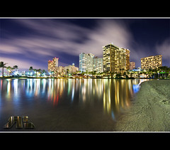 Hilton Pond Reflections (Ryan Eng) Tags: longexposure reflection water night photoshop lights hawaii pond waikiki oahu smooth hilton hotels streaks dri blending ilikai cloudmovement ryaneng