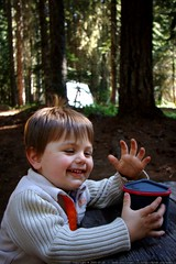 sequoia enjoys hot chocolate for his first camping breakfast - _MG_9929 (sean dreilinger) Tags: camping boy smile smiling youth happy washington sweater child gesturing bodylanguage content excited hh gesture talking youngster troutlake speaking campsite naturalbridges pleased campingtrip twoyearsold carcamping handgesture giffordpinchotnationalforest campingkid klickitatcounty sequoiaraindreilinger gulericecave 20090726 kidcamper