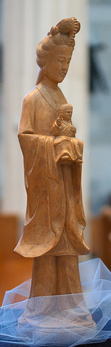 "Hand carved statue, The Holy Mother"", made in China, from the collection of the Marianum, photographed at the Cathedral of Saint Peter, in Belleville, Illinois, USA"