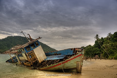 Wrecked Boat (sathyan.ram) Tags: old travel sea tree beach leaves weather clouds island coast boat sand nikon ship coconut getaway sandy stormy east explore coastal malaysia flickrcentral deserted perhentian wrecked hdr highdynamicrange terengganu hdri d90 flickrtoday visitmalaysia nikond90