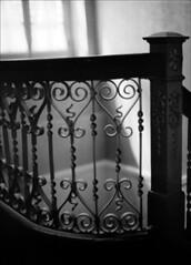 Heart (Jamie Powell Sheppard) Tags: blackandwhite bw 120 film architecture vintage mediumformat hotel photo heart antique fineart wroughtiron indiana resort restored mf kodaktrix400 stairrailing mamiya645protl femalephotographer westbadenspringshotel hc110dilb 80mmlens filmwins jamiepowellsheppard subthiaps believeinfilm