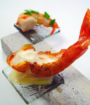 Custom made small transparent square appetizer glass plates attached to rectangular holder for shrimp appetizer presentation or for amuse bouche in fine dining presentation