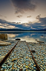RUSTY RAILROAD (~~~johnny~~~) Tags: ocean blue red sea sky fall norway clouds reflections rocks colours view searchthebest stones shoreline railway september 23 tamron beatiful wt troms potofgold nikond40 tamron1024mm