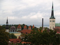 Old Town Tallin (wirralwater) Tags: old city trees roof cloud church town estonia rooftops spires tiles tallin