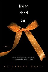 Living Dead Girl book cover, which is black with white writing that says Living Dead Girl above a ribbon tied into a bow that is yellow with white polka dots