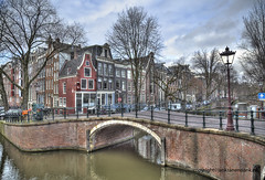 Amsterdam (Jan Kranendonk) Tags: boat canal amsterdam holland duch netherlands europe water buildings travel sky clouds landmarks quay architecture trees winter street scenic quiet bridge bikes bicycles cars parked mansions historical old streetlight lamppost ngc