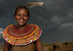 Smiling Pokot girl with a feather on the head - Kenya (Eric Lafforgue) Tags: africa portrait people face beads kenya african culture tribal human tribes bead afrika tradition tribe ethnic kenia tribo gens visage afrique ethnology tribu eastafrica rift beadednecklace pokot qunia 7455 lafforgue ethnie  qunia    beadsnecklace kea   pokhot africa east  humainpersonne a