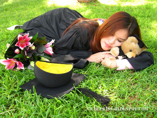 graduation photo_sleeping on grass
