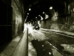Speed (Che-burashka) Tags: street urban blackandwhite bw motion brick london wet monochrome car speed puddle movement driving cab taxi streetphotography bn walls railing tunnels cabs puddles tgif southwark thriller wetstreet urbanspace urbanlyric welcomeuk