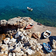Boats on the Rocks (irene gr) Tags: blue sea seascape square boats rocks olympus 11 explore frontpage zuiko e30 43 zd fourthirds 1454mm topshots f2835 zuikodigital 1454mmii irenegr eikoneselladas