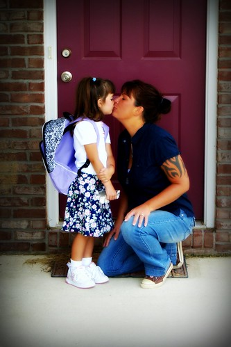 Kissing mommy good bye on the first day of school